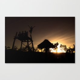 fly with the sunset Canvas Print