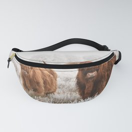 Hairy Scottish highlanders in a natural winter landscape. Fanny Pack