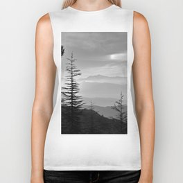 Rainbow clouds at the mountains at sunrise. BW Biker Tank
