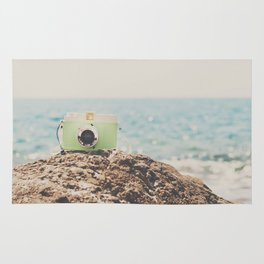 "the ""dreamer"", a mint green camera with the ocean behind it Rug"