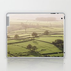 Hazy light at sunset over a valley of fields. Derbyshire, UK. Laptop & iPad Skin