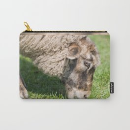Single adult sheep eating grass Carry-All Pouch