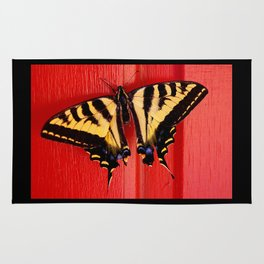 tiger swallowtail butterfly on unusual background Rug