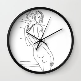 Woman in a jumpsuit Wall Clock