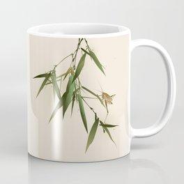 A grasshopper on bamboo leaves Coffee Mug