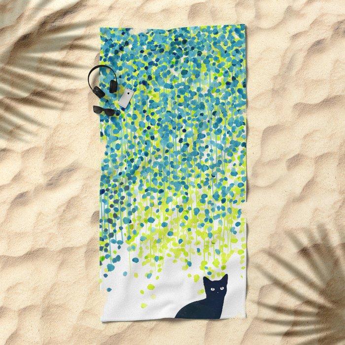 Cat in the garden under willow tree Beach Towel