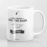 marley Mugs featuring Marley Quote - Some people feel the rain, others just get wet. by Spyros Athanassopoulos