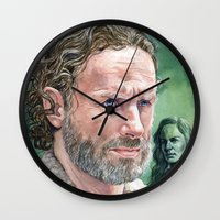 rick grimes Wall Clocks featuring Rick Grimes by Mark Satchwill Art