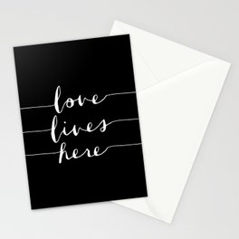 Love Lives Here black and white modern typography minimalism home room wall decor Stationery Cards