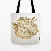 tree rings Tote Bags featuring Tree Rings by Emmy Winstead