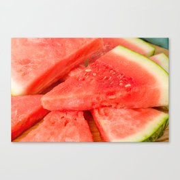 Slices of watermelon on a wood cutting board Canvas Print