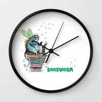 bookworm Wall Clocks featuring Bookworm by TheVioletWall