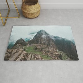 Ancient Inca ruins of Machu Picchu and surrounding Andes mountains in the early morning, Peru Rug