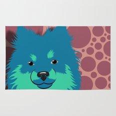 Olie the Pomeranian in Blue Rug