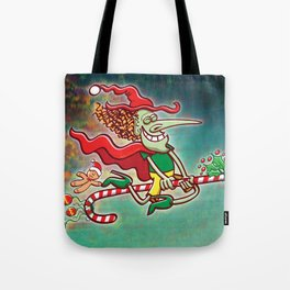 Halloween witch flying on a Christmas candy cane Tote Bag