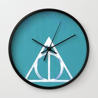deathly hallows Wall Clocks featuring Deathly Hallows - Blue by Phoenix Prints