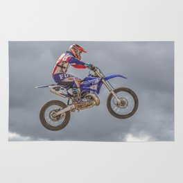 Action motocross biker in blue and red Rug