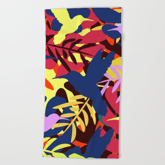 A tropical flight Beach Towel