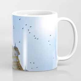 Pigeons Flying through the Sun in front of Chowmahalla Palace in Hyderabad, India Coffee Mug