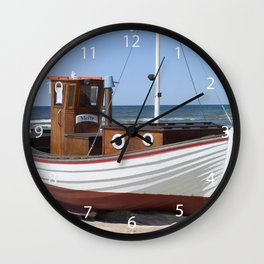 Wooden fishing boat on the beach. Wall Clock