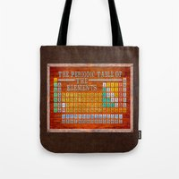 periodic table Tote Bags featuring Vintage Industrial Periodic Table Of The Elements by Mark E Tisdale