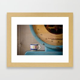 Cup and Scale Framed Art Print