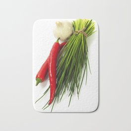 A bunch of fresh chives and vegetables over white Bath Mat
