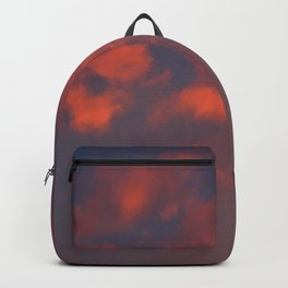Red clouds shining at sunset Backpack