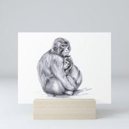 Snow monkey and baby Mini Art Print