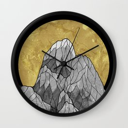 The Golden moon rises over the highest peak Wall Clock