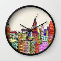 new york skyline Wall Clocks featuring new york city skyline by bri.buckley