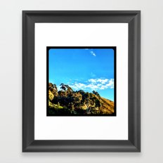 Trees and clouds in the sky. Framed Art Print