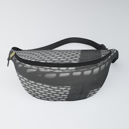 Bench seat with shadow pattern black and white photographic print Fanny Pack