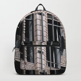 BROWN CONCRETE BUILDING WITH GLASS WINDOWS Backpack