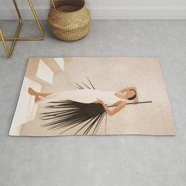 Minimal Woman with a Palm Leaf Rug