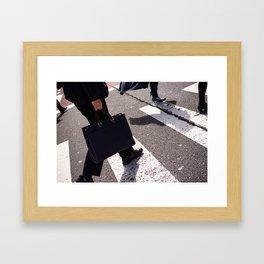 Group of businessmen and women walk along crosswalk in Shinjuku, Tokyo, Japan Framed Art Print