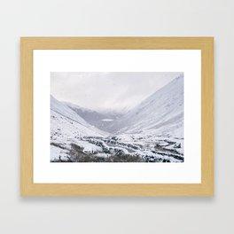 Heavy snow falling over the Kirkstone Pass. Cumbria, UK. Framed Art Print