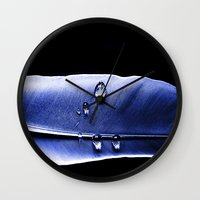 the 100 Wall Clocks featuring 100 Suns by Brian Raggatt