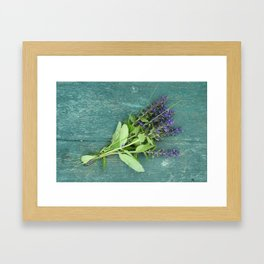 Bouquet of violet flowers on a painted green bench Framed Art Print