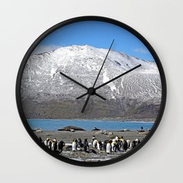 Snowy mountain with King Penguins in the Foreground Wall Clock