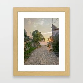 Little alley in the medieval center of the village Rovinji at sunset Framed Art Print