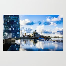 View of Boats on the Sea behind the Harpa Concert Hall in Reykjavik, Iceland Rug