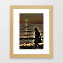 Sunset and lonely silhouette on the beach Framed Art Print