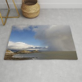 Lighthouse and approaching storm Rug
