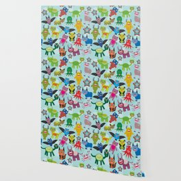 Cute cartoon Monsters seamless pattern on blue background Wallpaper