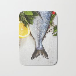 fresh dorado fish and vegetables on wooden board Bath Mat