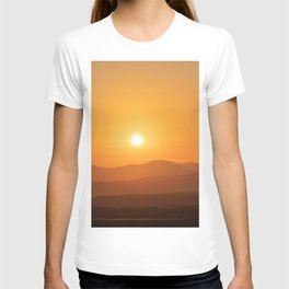 Winter sunrise, orange sky over mountains T-shirt