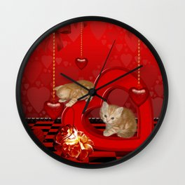Cute, playing kitten Wall Clock