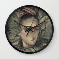frida kahlo Wall Clocks featuring Frida Kahlo by Antonio Lorente