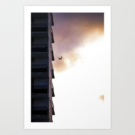 Flying through a cloudy sky at sunset - City photography print Art Print